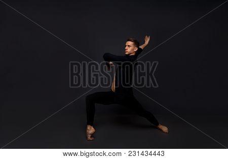 Men Is Dances In A Black Shirt