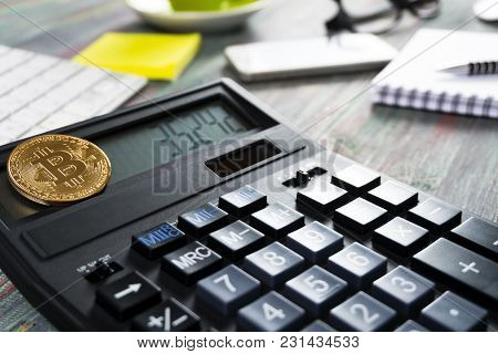 Bitcoin And Keyboard Calculator In A Business Office. Bitcoin Golden Coin New Virtual Money