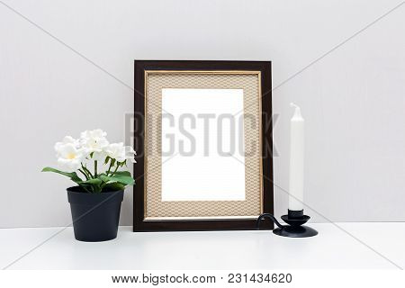 Mockup 8x10: A Dark Wooden Frame With With Flowers And White Candle. Vertical Orientation.