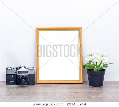A Minimalistic 8x10 Mockup With A Camera And Flowers. Portrait Orientation.