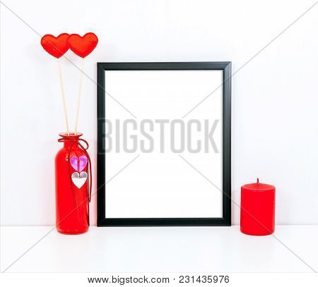 Mockup 8x10 Thin Black Frame With A Red Candle And Hearts. Portrait Orientation.