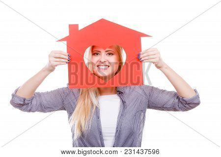 Ownership And Property Concept. Happy Woman Holding Red Paper House With Hole In Heart Shape, Loving