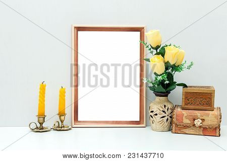 A4 Wooden Frame Mockup With Yellow Flowers And Boxes. Portrait Orientation.