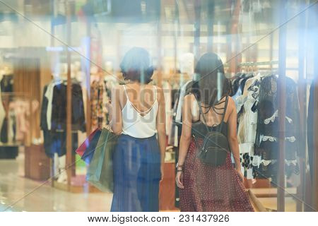 Rear View Of Young Women Walking In Shopping Mall