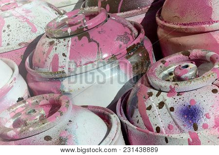 A Lot Of Used Pink Metal Tanks With Paint For Drawing Graffiti