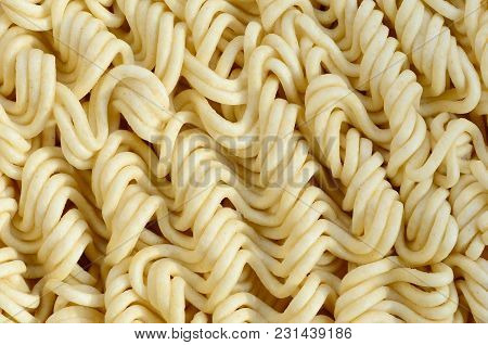 Close Up View Of Yellow Dry Instant Noodles. Chinese Traditional Food