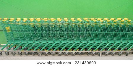 Shopping Carts Trolleys On A Parking Lot Banner Background