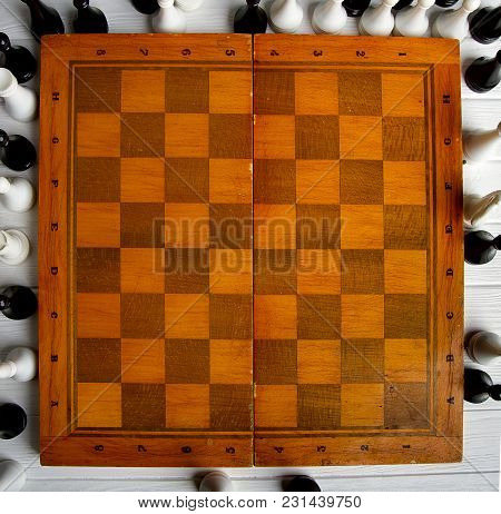 Old Chess Around An Empty Chessboard Classic Wooden Board