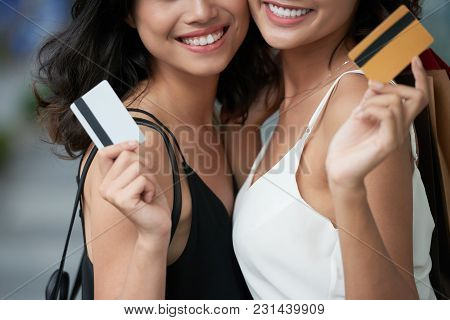 Cropped Image Of Smiling Young Women With Credit Cards