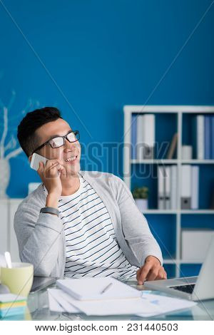 Portrait Of Cheerful Vietnamese Businessman Calling On The Phone