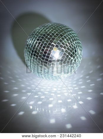 Mirror Ball.isolated On A Dark Background.photo With Copy Space