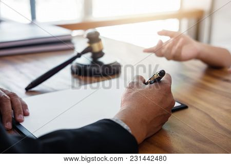 Male Lawyer Or Judge Consult Having Team Meeting With Client, Law And Legal Services Concept.