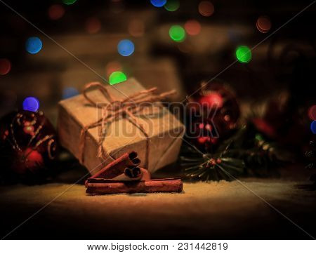 Christmas Gift And Christmas Tree Decorations On The Background Of Christmas Lights.photo With Copy
