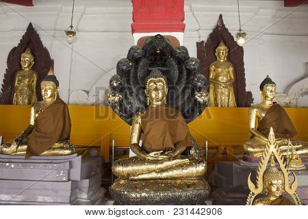 Thai People Respect And Praying Golden Buddha Statue In Ubosot Of Wat Phra Mahathat Woramahawihan On