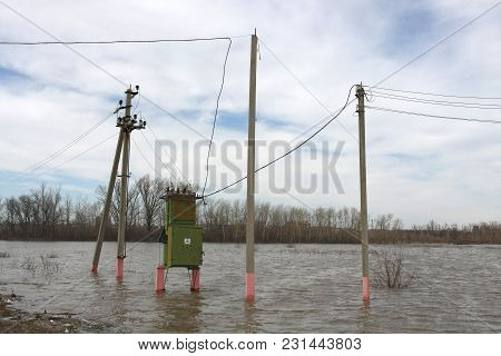 Transformer In Flood. Danger Of Water And Electricity.