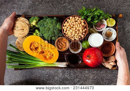 Food Ingredients Of Asian Cuisine On A Bamboo Tray And Men's Han
