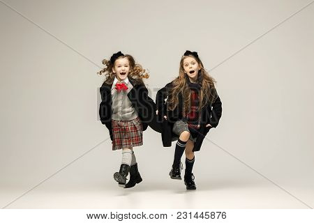 The Fashion Portrait Of Young Beautiful Teen Girls At Studio