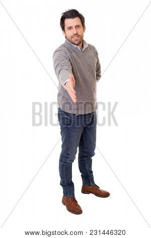 handshake of a happy casual man full body  in a white background