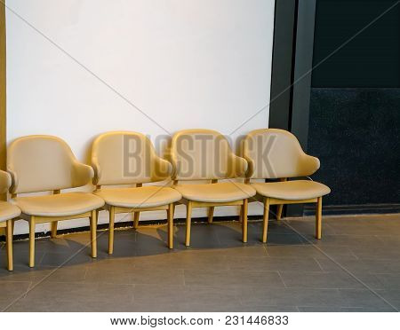 Row Of Light Brown Chairs In The Hallway. Leather Chairs Alignment In A Waiting Area.