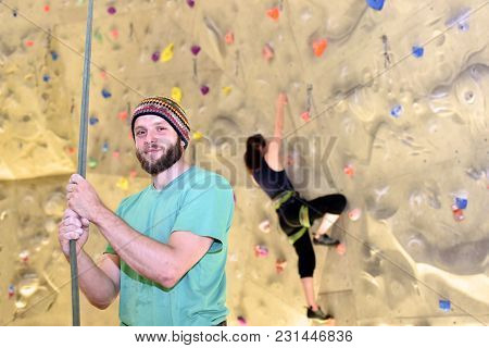 People Bouldering In A Climbing Hall - Indoor Sports