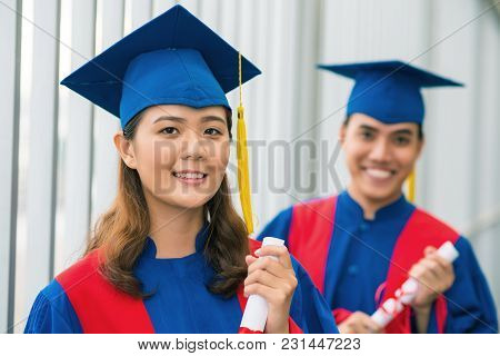 Portrait Of Pretty Smiling Female Student In Graduation Hat