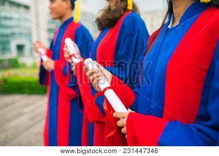 Cropped Image Of Graduates With High School Diplomas