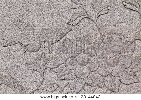 Bird carved on stone wall in chinese temple Thailand poster