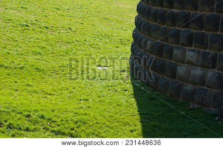 Particular Of A Wall In Contrast With The Green Of The Lawn - Italy