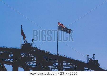 Sydney, Australia - July 11th, 2013: Australian And Aboriginal Flag Waving On Top Of The Sydney Harb