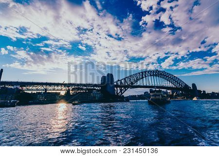 Sydney, Australia - July 12th, 2013: Sydney Harbour Bridge At Sunset With Sun Flare Shot From The Fe