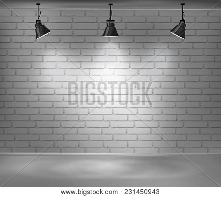 Empty Brick Wall. Blank Room Is Illuminated By Three Lamps. Background For Advertising Indoors. Stoc