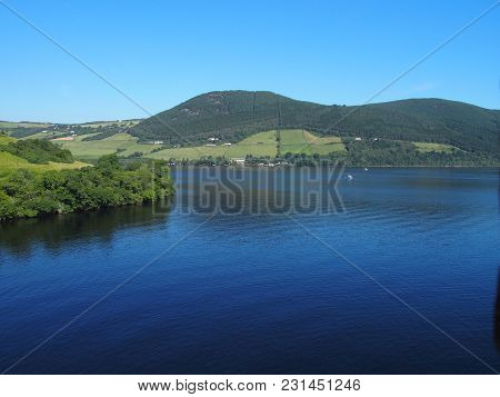 Loch Ness Lake Landscapes In Scotland Near Ruins Of Medieval Urquhart Castle In United Kingdom, Grea