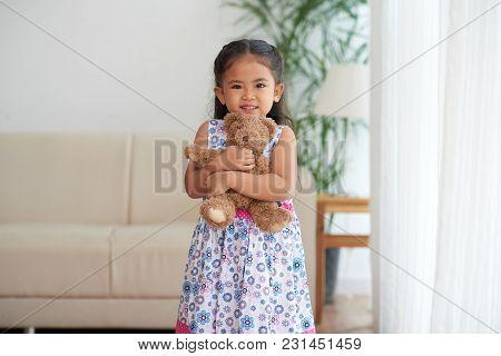 Adorable Little Girl With Her Teddy Bear