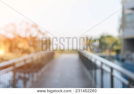Abstract Blurred Image Of Walkway Over The Outdoor Swimming Pool For Background