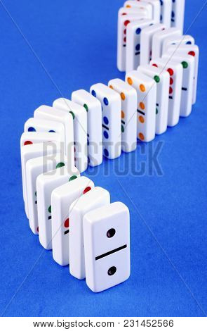 S Shape Curve Of Standing Dominoes, In Front Is Double One. Leadership Concept.
