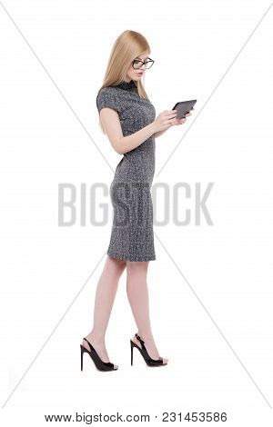 Young Smart Blonde Caucasian Businesswoman In Eyeglasses Holding Tablet Side View, Isoalted On White