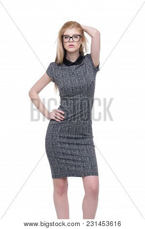 Young Smart Businesswoman In Gray Dress Ad Eyeglasses Posing Isolated On White