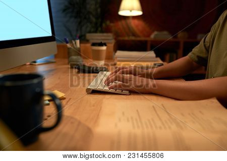 Hands Of Business Woman Working In Dark Office