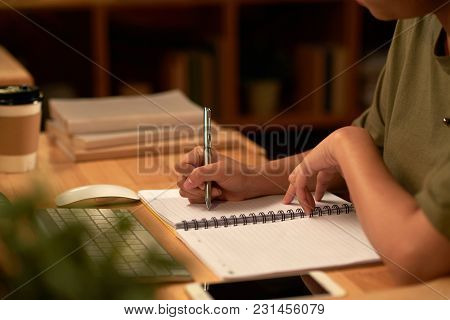 Cropped Image Of Female Student Writing Essay Late At Night