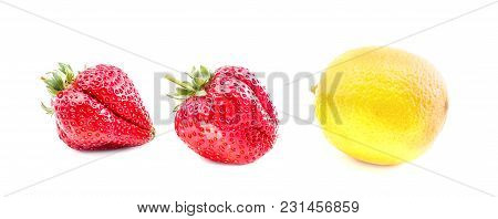 Lemon And Two Strawberries Isolated On White Background