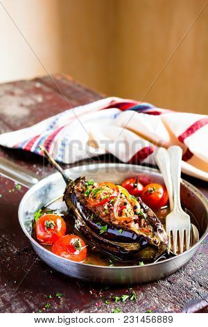 Traditional Turkish Dish Of Eggplant. Baked In The Oven Stuffed Eggplant With Pork And Beef Meat, Re