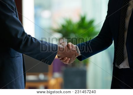 Business People Shaking Hands To Confirm Deal