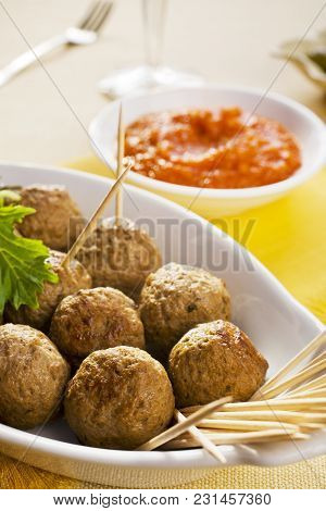 Spanish Tapas, Albondigas Or Meatballs, With Spicy Dipping Sauce.