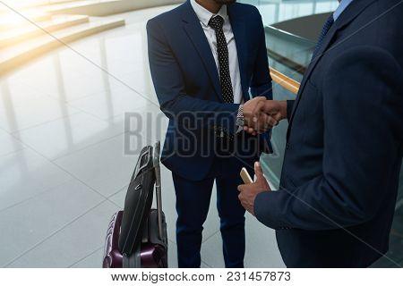 Close-up Image Of Business Partners Shaking Handsat Train Station