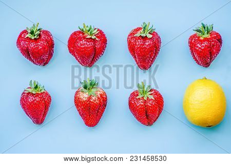 Two Lines Of Strawberries On Blue Background Topview