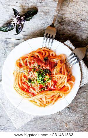 Traditional Italian Food. Pasta Spaghetti Alla Vodka With Cream Sauce, Tomatoes, Parsley And Basil O