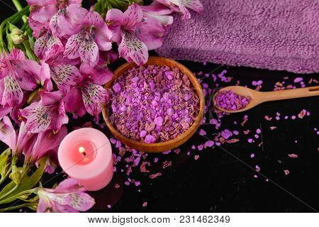 Spa background-towel, pink orchid, and spoon ,petals in bowl, candle