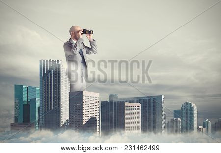 Big Businessman Emerges From The Skyscrapers With Binoculars