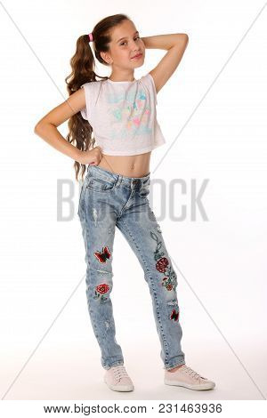 Portrait Of Happy Slender Cheerful Teenage Girl In Full Body. The Child Elegantly Poses And Smiles.