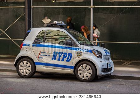 Police Nypd Smart Car On The Manhattan Street.